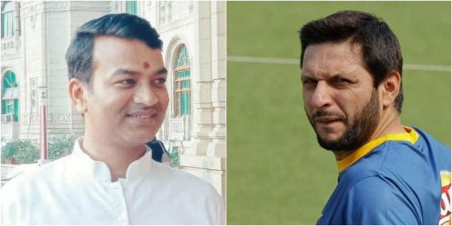 Uttar Pradesh minister Anand Swaroop Shukla (L) and Pakistan cricketer Shahid Afridi
