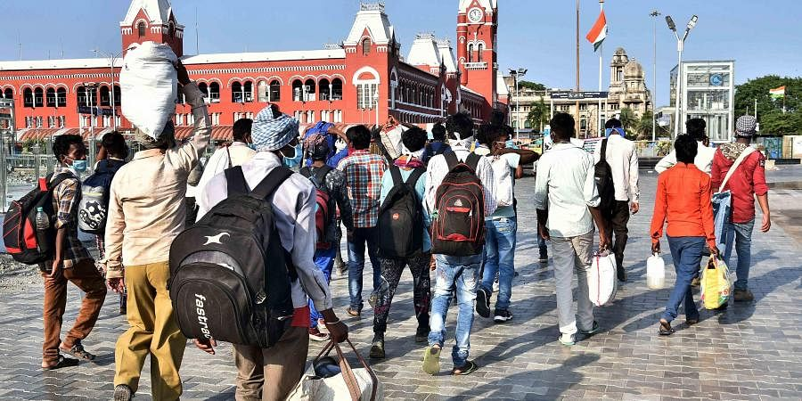 Migrant workers arriving at Chennai Central in hope of catching a train