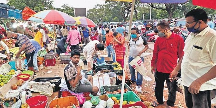 People ignore social distancing norms while buying fruits for Sabitri Brata at Kalpana vending zone in Bhubaneswar and Dolamundai in Cuttack on Thursday.