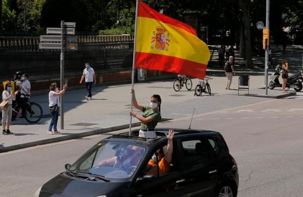 Spain's far-right holds car protest against coronavirus lockdown