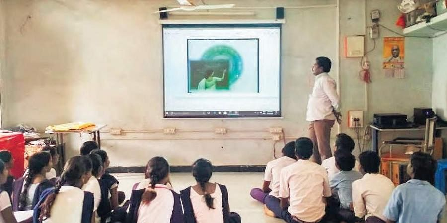 Students attend digital classes at one of the govt schools