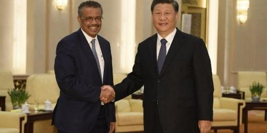 WHO Director General Tedros Adhanom Ghebreyesus with President Xi Jinping