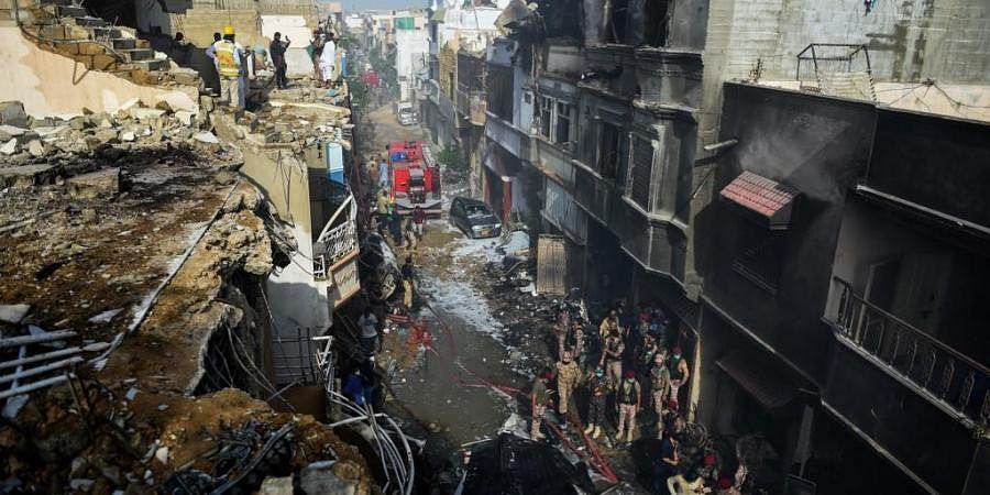 A Pakistani plane with nearly 100 people on board crashed into a residential area in the southern city of Karachi on May 22. (Photo   AFP)