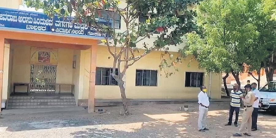 Officials outside the institutional quarantine centre at Gokak on Saturday