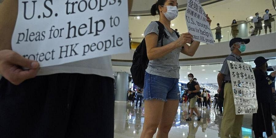 Protester display placards in a shopping mall during a protest against China's proposed tough national security legislation for the city in Hong Kong