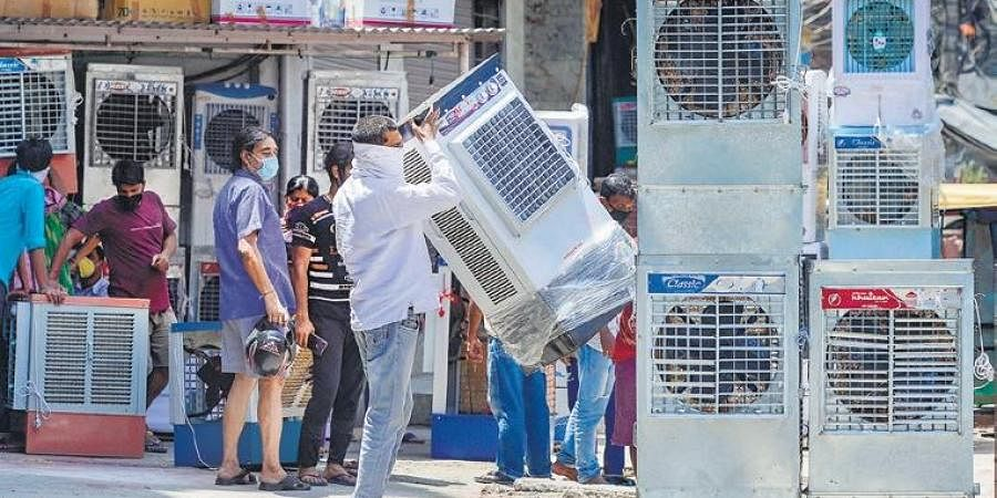 People purchase air coolers on a hot summer day, in New Delhi on Sunday