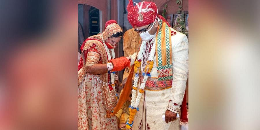 A couple wearing face masks during their marriage ceremony amid the ongoing COVID-19 nationwide lockdown in Bikaner