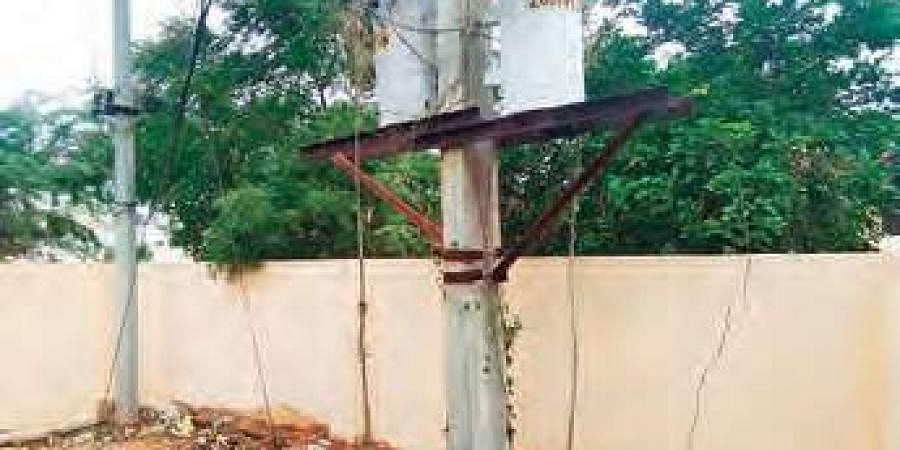 The transformer mounted on a pole on the school premises in Bakaram Jagir village   Express Photo