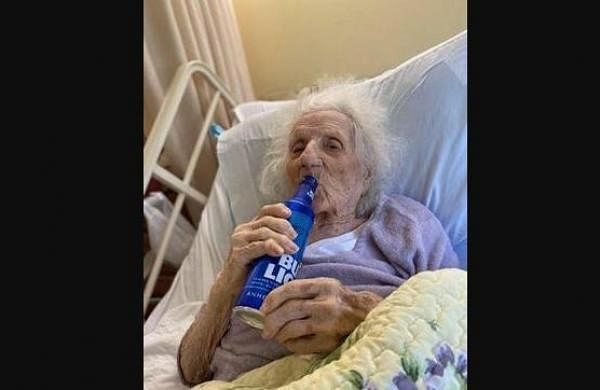 Cheers! 103-year-old great-great grandmother downs beer pint after recovering from COVID-19