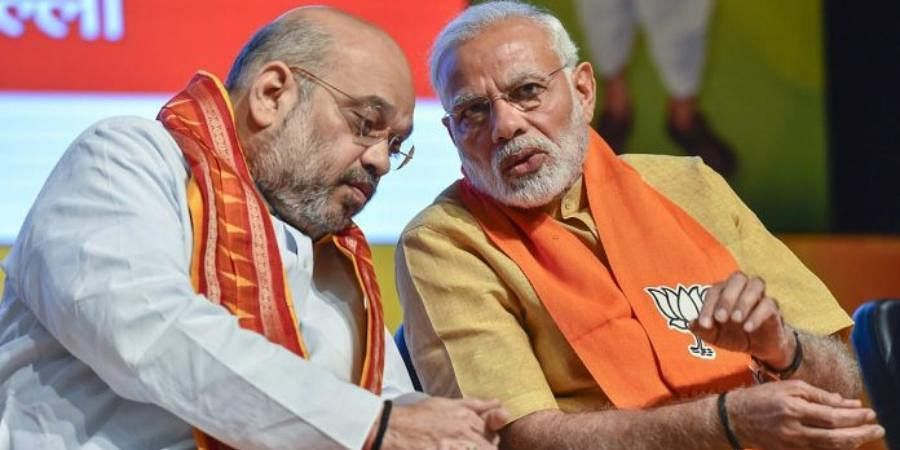 Home Minister Amit Shah (L) and PM Narendra Modi