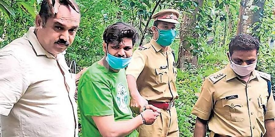 Police officials take Sooraj to his house for evidence collection.