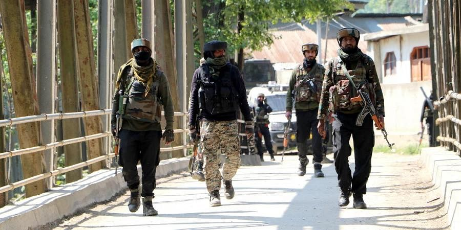 Army jawans leave after the end of an encounter with militants, at Melhora in Shopian on Wednesday