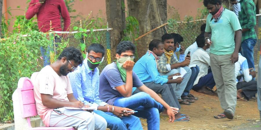 Migrant labor waiting to go back to their home places at Sub Collector office in Vijayawada on Saturday.