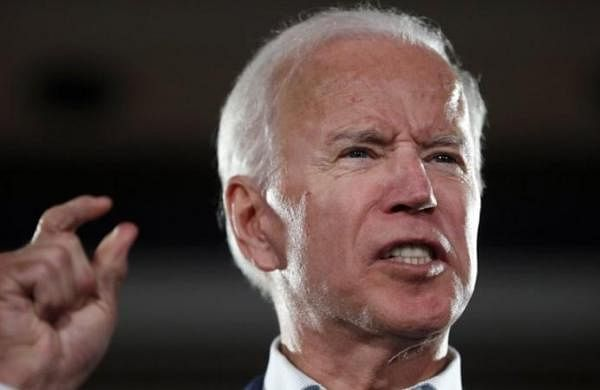 Joe Biden speaks of racial 'open wound,' contrasting with US President Donald Trump