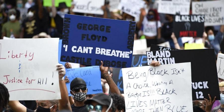 George Floyd death: 'I can't breathe' a rally cry anew for police ...