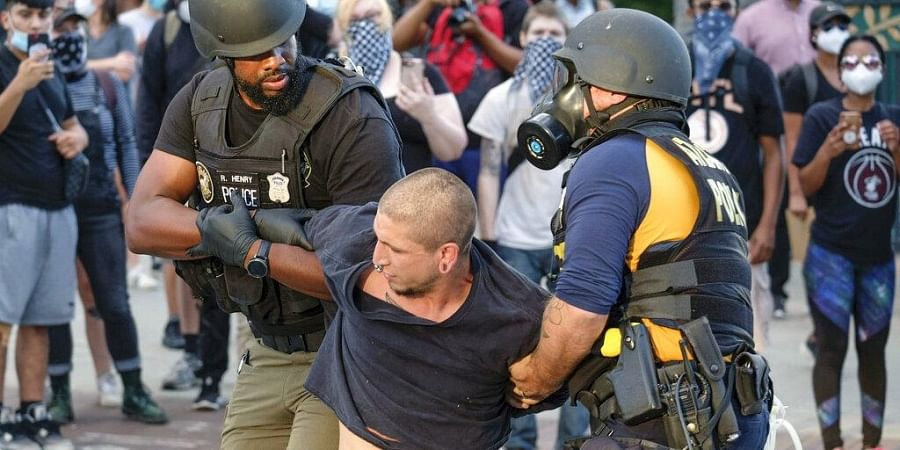 Police make arrests outside Centennial Olympic Park as protests continued for a second day over the death of George Floyd, Saturday, May 30, 2020 in Atlanta.