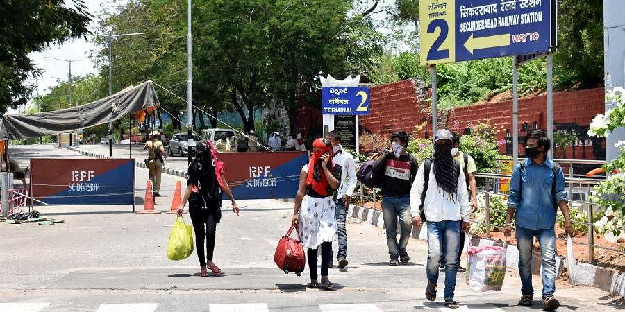 Migrants walking out of Secunderabad railway station after knowing that no train was arranged for them at secunderabad railway station on sunday.