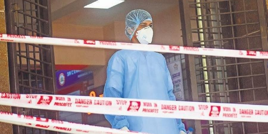 A doctor takes a break from work at CV Raman Hospital in Bengaluru