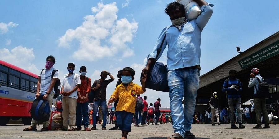 Various state governments including Delhi, Kerala, Andhra, Telangana, Bihar and others have started sending migrants back home. In Karnataka, buses have been arranged allowing 30 passengers each keeping social distancing in mind. (Photo | Shriram BN, EPS)
