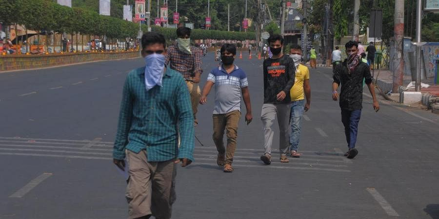 Migrant workers on their way to Sub-Collector office seeking help to return go to their respective hometown during the ongoing lockdown in Vijayawada