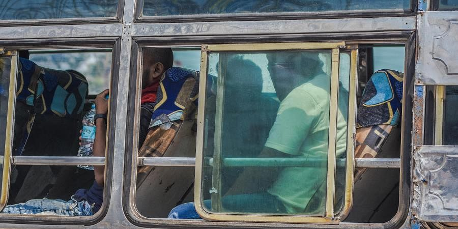 A bus carries migrant labourers from Khordha Road Railway Station to their respective destination in Bhubaneswar on Monday.