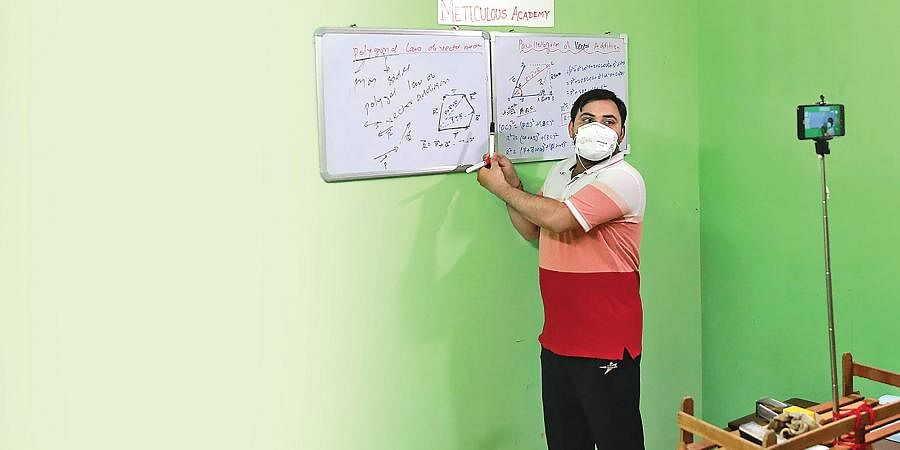 PWD engineer Sudhir Kishore takes an online class on YouTube for Class 11 and Class 12 students during the lockdown