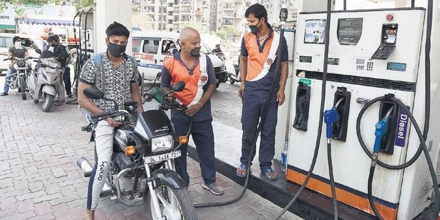 A biker gets his two-wheeler refueled at a petrol pump in New Delhi. The base price of petrol in Delhi on May 6 was Rs 19. But an additional almost Rs 50 was added in taxes, not to mention a dealer commission of Rs 3.60.