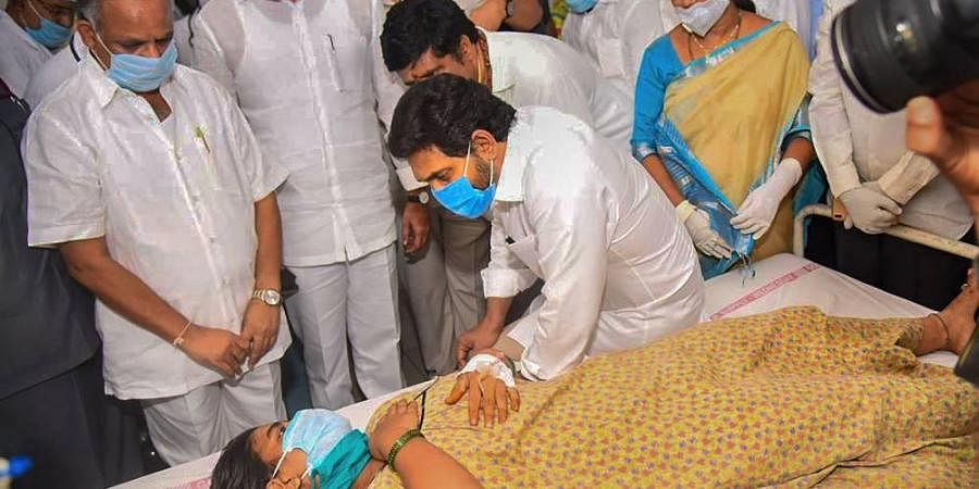 Andhra Pradesh Chief Minister YS Jagan Mohan Reddy interacts with a woman victim of the styrene chemical gas leak incident being treated at KGH Hospital in Visakhapatnam