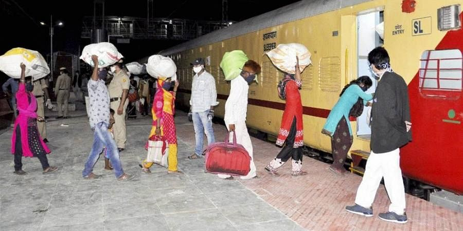 Migrant workers arrive to board a special Maharashtra-bound train to reach their homes amid ongoing COVID-19 lockdown at Rayanapadu Railway station near Vijayawada.