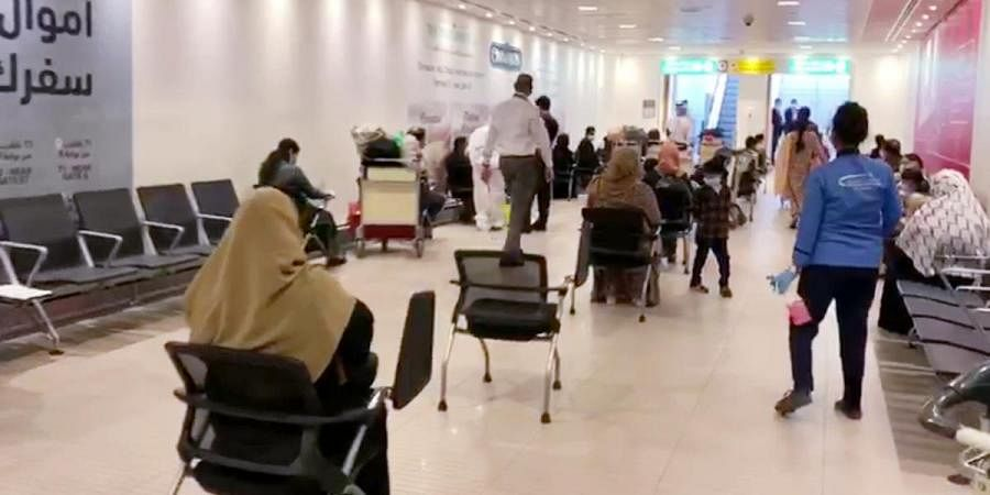 Indian nationals, all from Kerala are being brought back from Abu Dhabi under Vande Bharat Mission during coronavirus lockdown, at Abu Dhabi airport in Abu Dhabi on Thursday