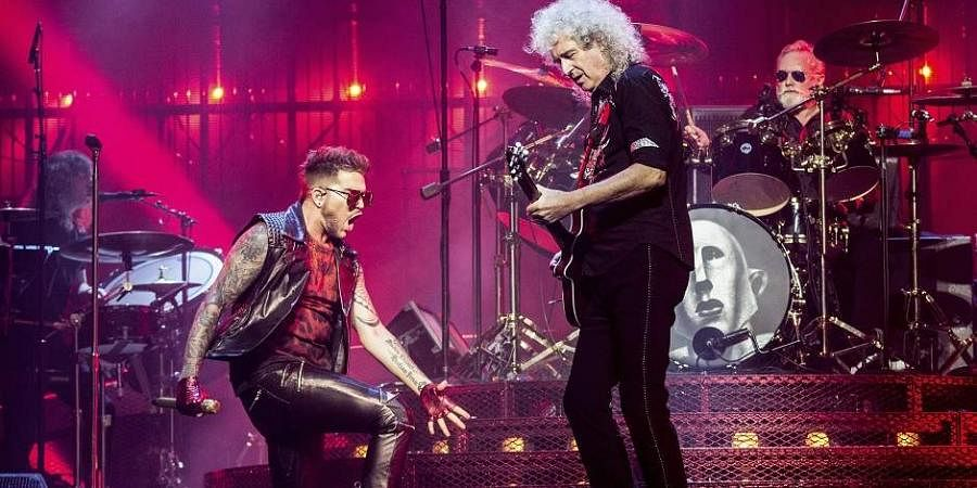 Adam Lambert (L) Brian May and Roger Taylor of Queen.