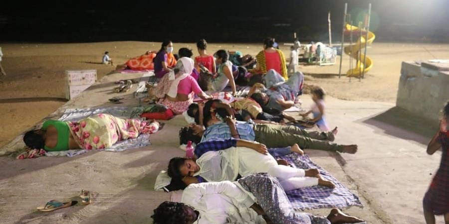 People who moved out of their homes in Gopalapatnam, Madhavadhara and Kancharapalem areas sleeping on beach road in Visakhapatnam.