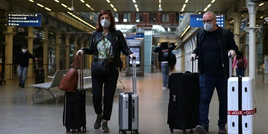 Passngers wearing a facemask arrive at the Eurostar terminal at St Pancras station in London. (Photo | AFP)