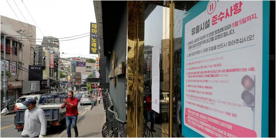 A notice of guidelines that entertainment facilities should follow is posted at the entrance of a nightclub in Seoul, South Korea, Friday, May 8, 2020.