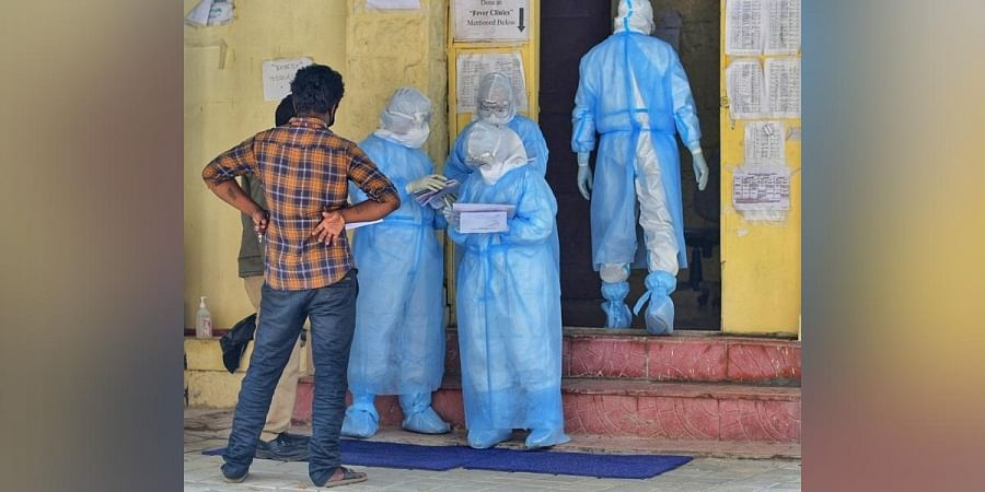 Doctors attend to patients at Victoria Hospital in Bengaluru