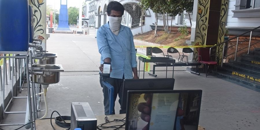 Ticket scanning camera fixing in the view of resuming train services at Vijayawada railway station on Sunday.