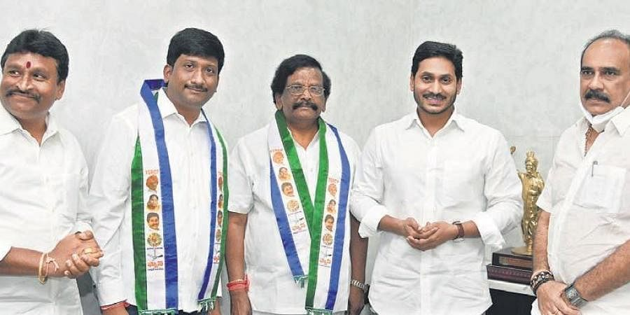 Former minister Sidda Raghava Rao and his son with CM YS Jagan Mohan Reddy in Tadepalli on Wednesday I Express