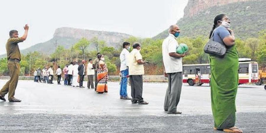 Pilgrims maintain physical distance at Alipiri toll gate on Thursday