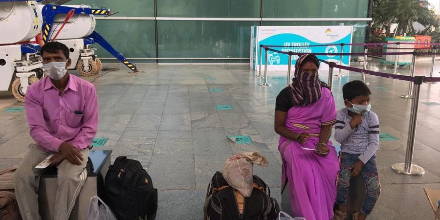 Migrant workers from Tamil Nadu heading to Chhattisgarh waiting for their flight at Kempegowda International Airport in Bengaluru.