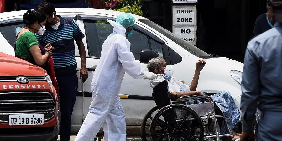 A medical worker in PPE kit at the emergency ward at sant Parmanand hospital in New Delhi