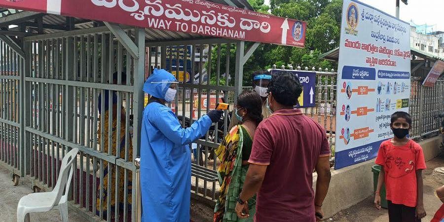 Devotees undergoing thermal screening at Kanaka Durga temple in Vijayawada.