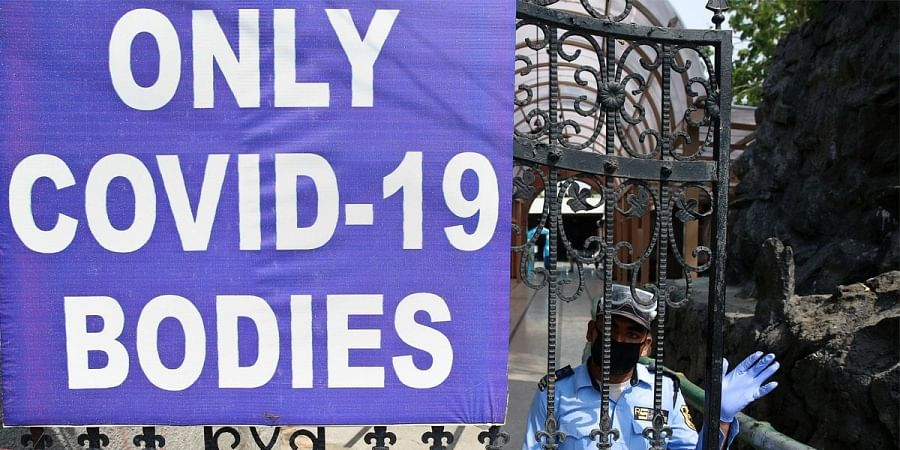 A notice board restricts bodies for cremation to that of COVID-19 victims at the Punjabi Bagh crematorium during the ongoing nationwide lockdown in New Delhi