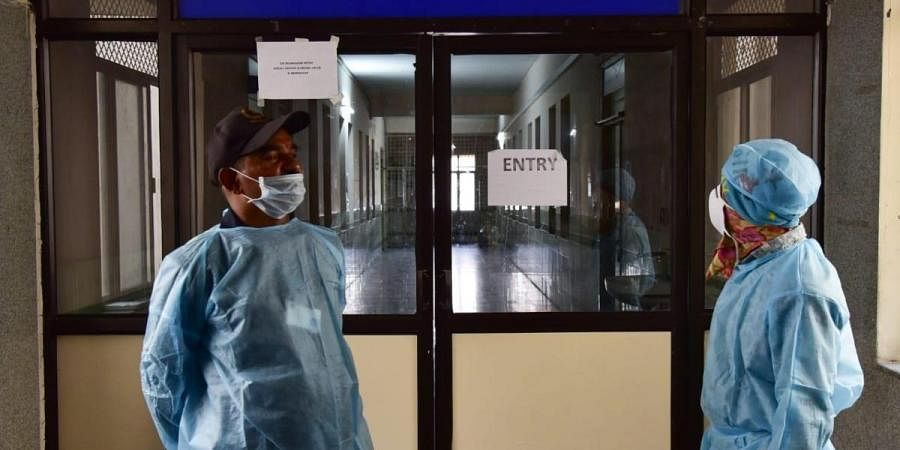 Private security wearing fully protective clothes at an Isolation ward specially for coronavirus patinents at Gandhi Hospital on Monday as one suspect patient who arrived from Dubai was admitted on Monday