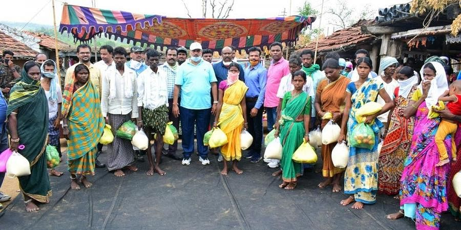 Nirmal SP C Shashidhar Raju distributes rice and other essentials to 50 Kolamguda tribal families in the district
