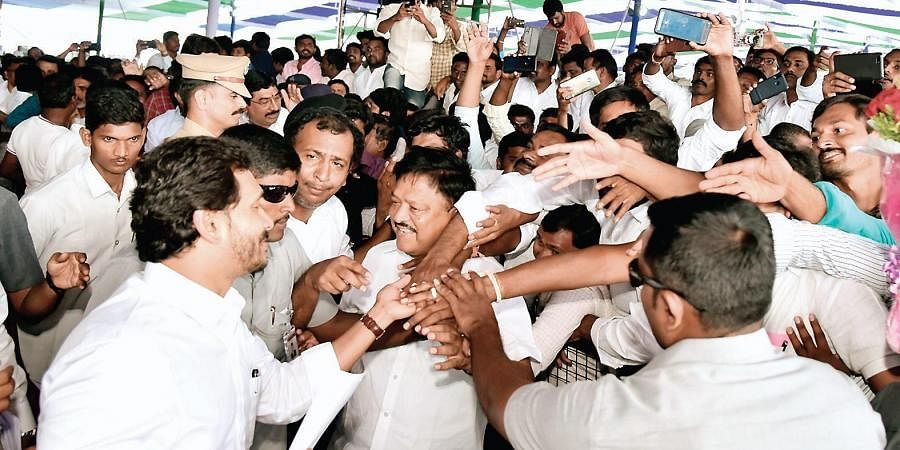 Chief Minister YS Jagan Mohan Reddy interacts with people after laying stone for Kadapa steel plant on Monday