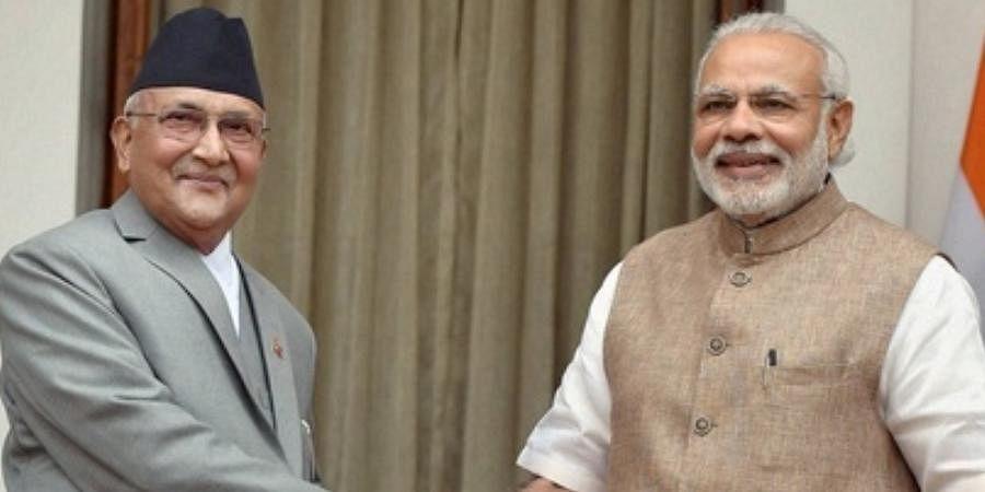 PM Narendra Modi and his Nepalese counterpart Khadga Prasad Sharma Oli