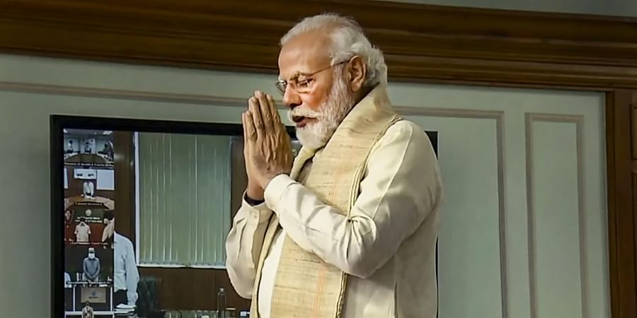 Narendra Modi folds his hands in solidarity for the sacrifices of soldiers along the border with China during an interaction with chief ministers and representatives of 14 states and the union territory of Jammu and Kashmir on COVID-19 preparedness in New Delhi.