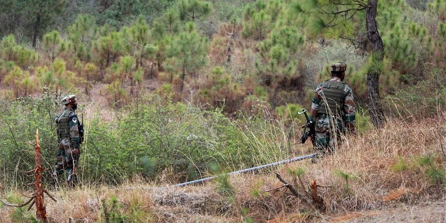 Indian army soldiers patrol near the Line of Control in Poonch district after a ceasefire violation by Pakistan.