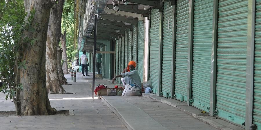 A road side vendor waits for the costumers at closed Janpath Market due to fear of coronavirus