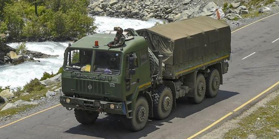 An Army convoy moves along the Srinagar-Leh National highway.